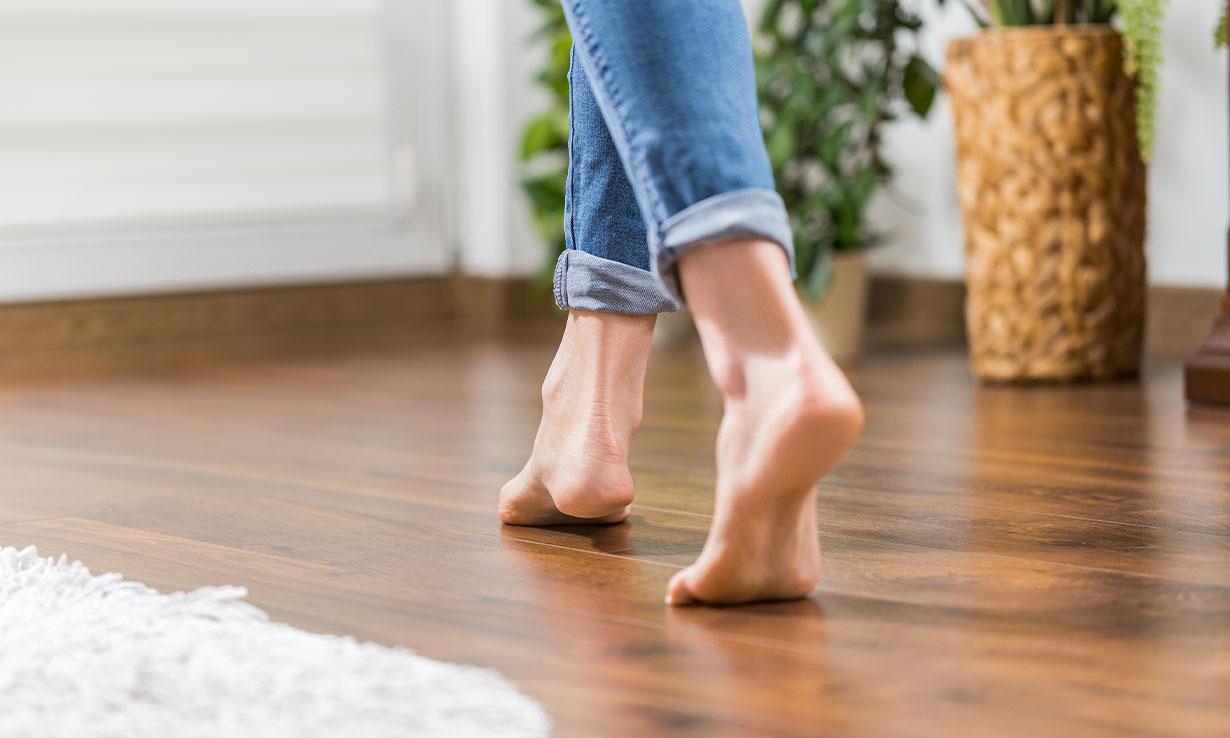 walking on wooden flooring