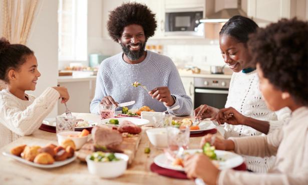 Family eating roast dinner