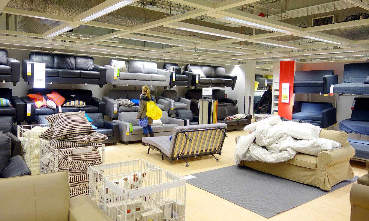 Customer looking at Ikea sofas