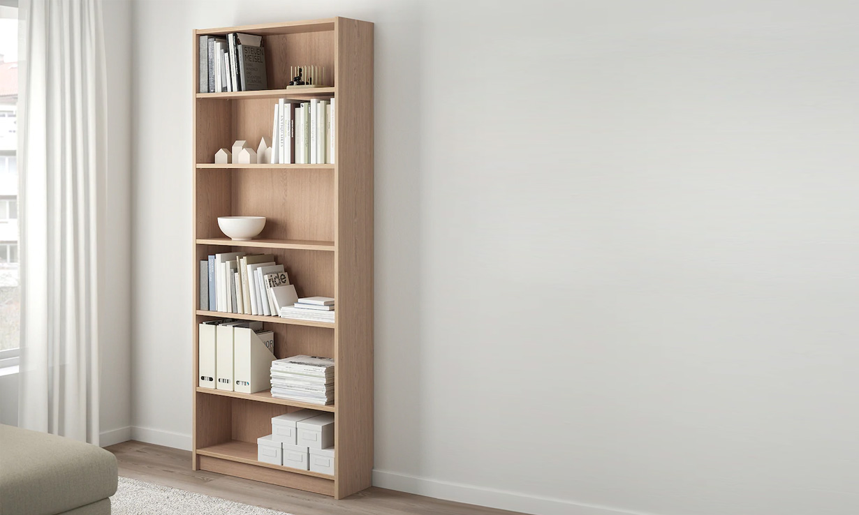 Ikea Billy bookcase containing books and ornaments
