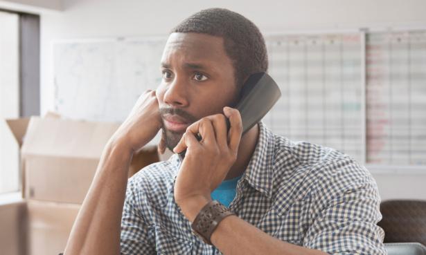 man bored on phone