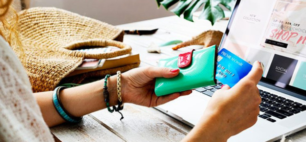 Woman with credit card and purse