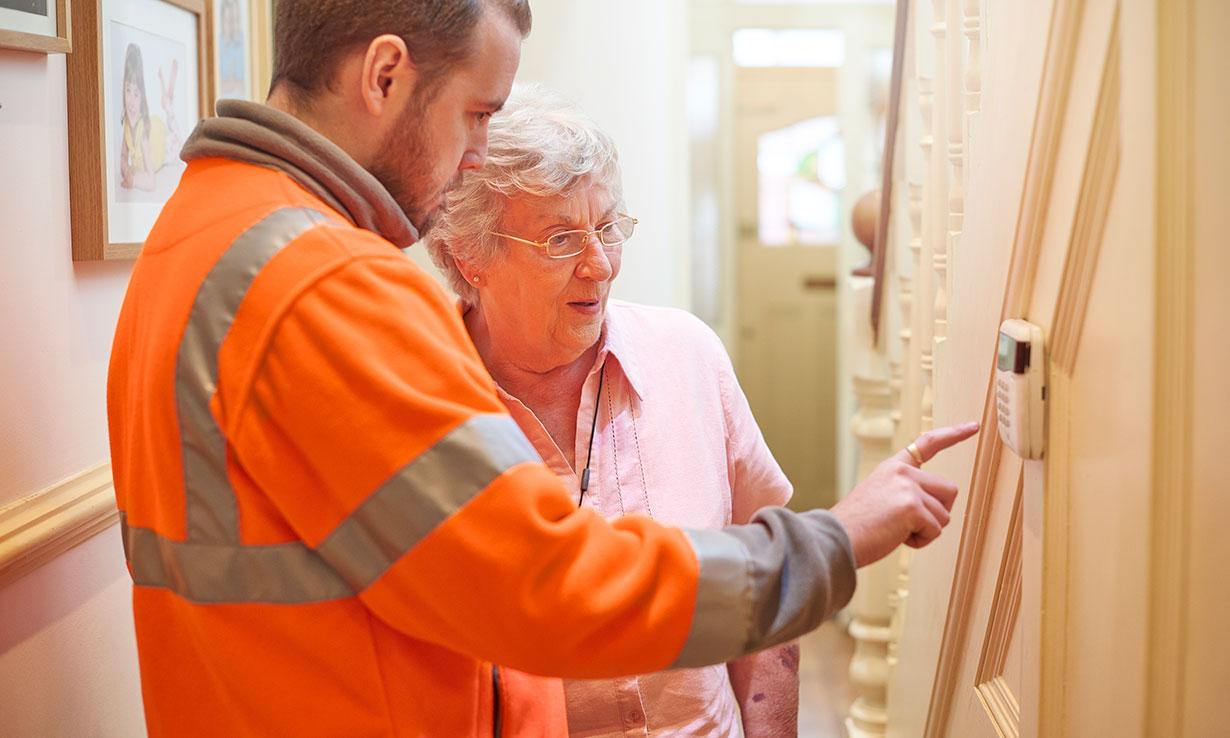 Boiler engineer talking to customer
