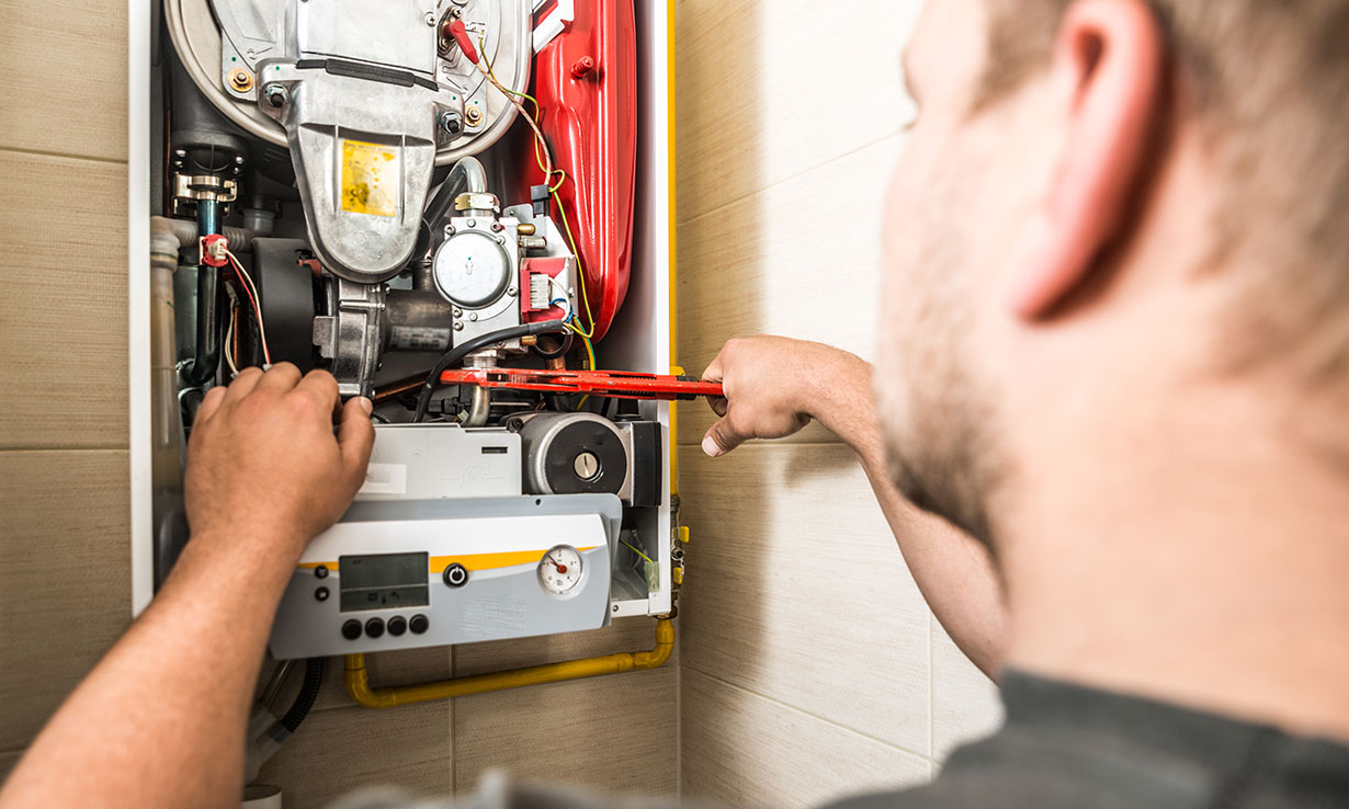 Trained engineer fixing a Boiler