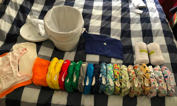 Collection of reusable nappies and liners with nappy bucket