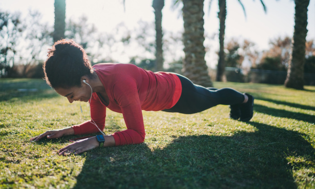 Woman exercising with a smartwatch