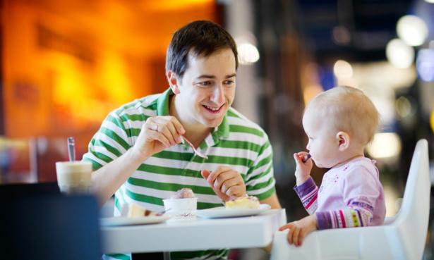 Father feeding child