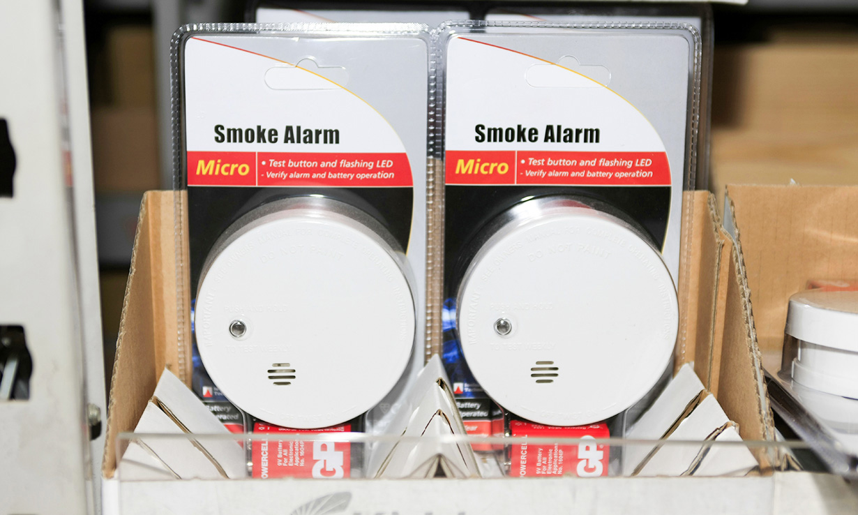 Two round smoke alarms for sale in a shop
