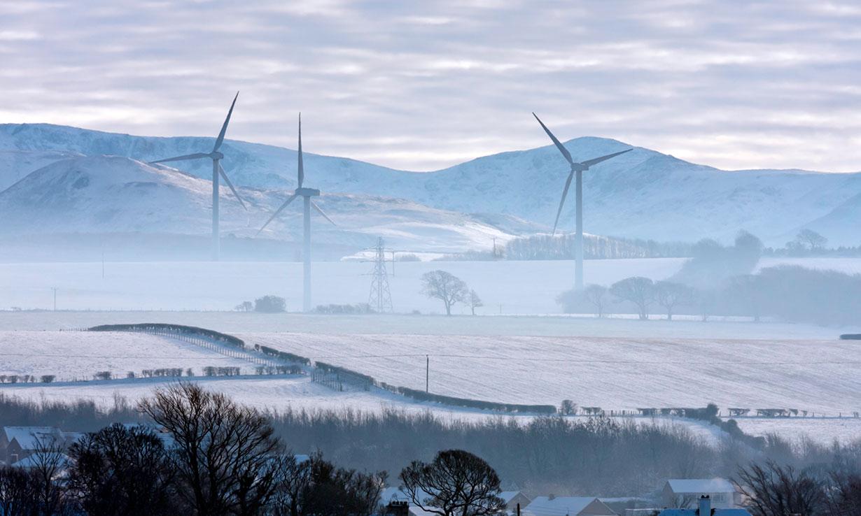 Wind turbines in snowy fields