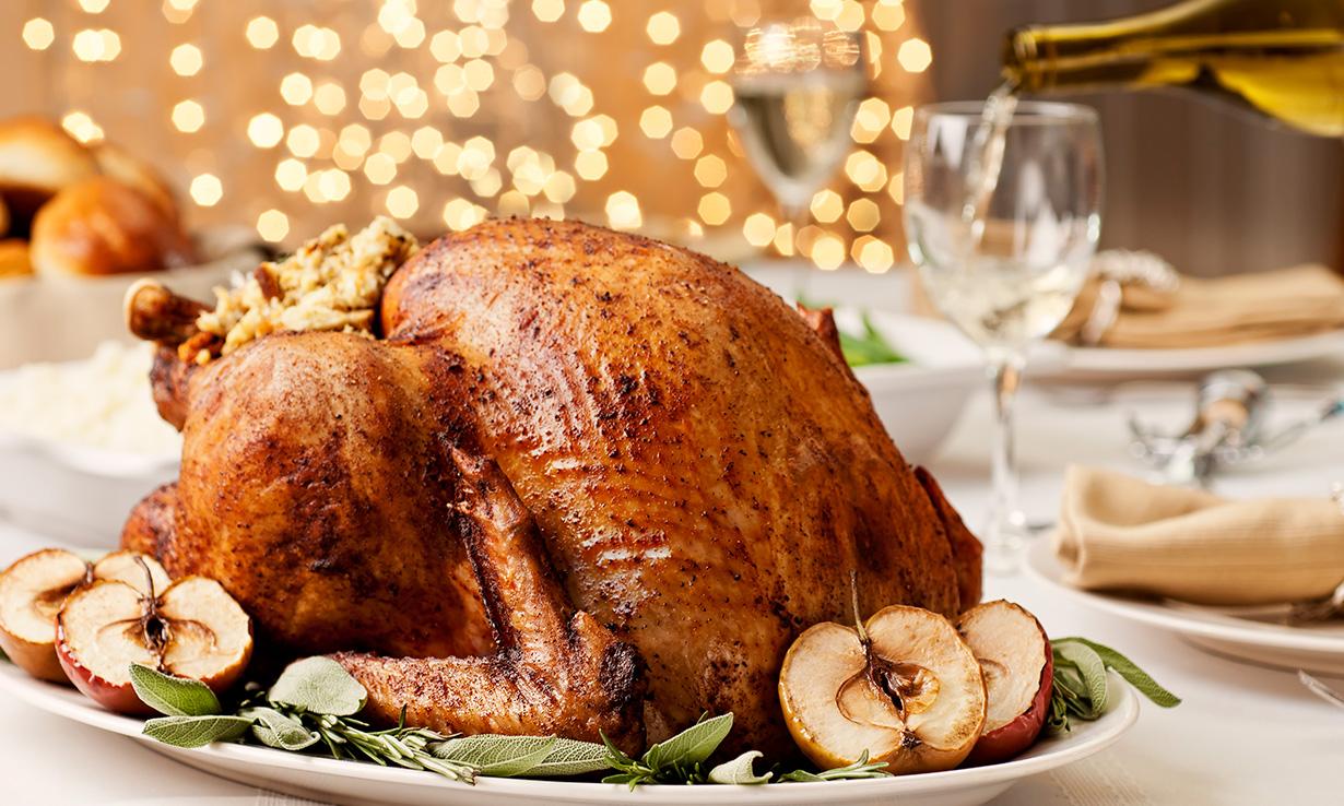 Roast turkey Christmas dinner on the dining table