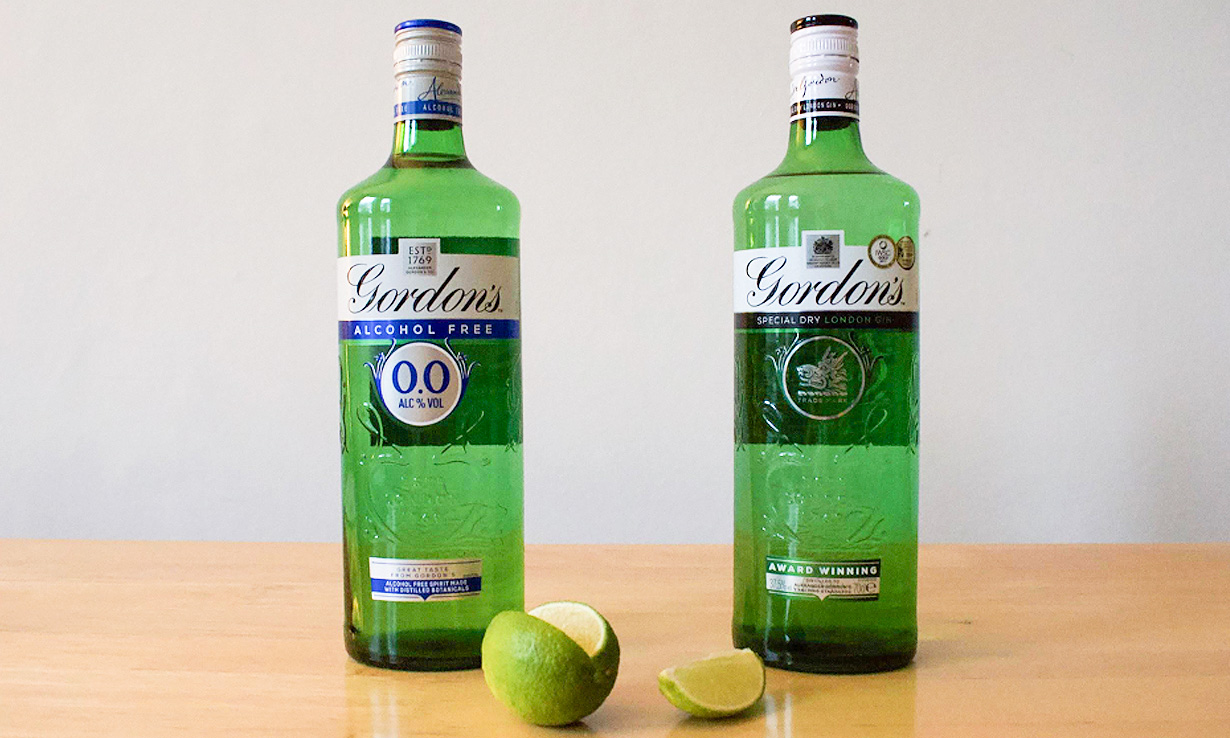 A bottle of Gordon's gin next to a bottle of Gordon's alcohol free gin