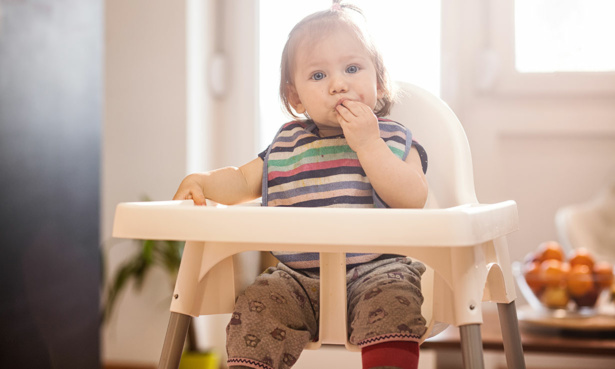 Toddler sat in high chair