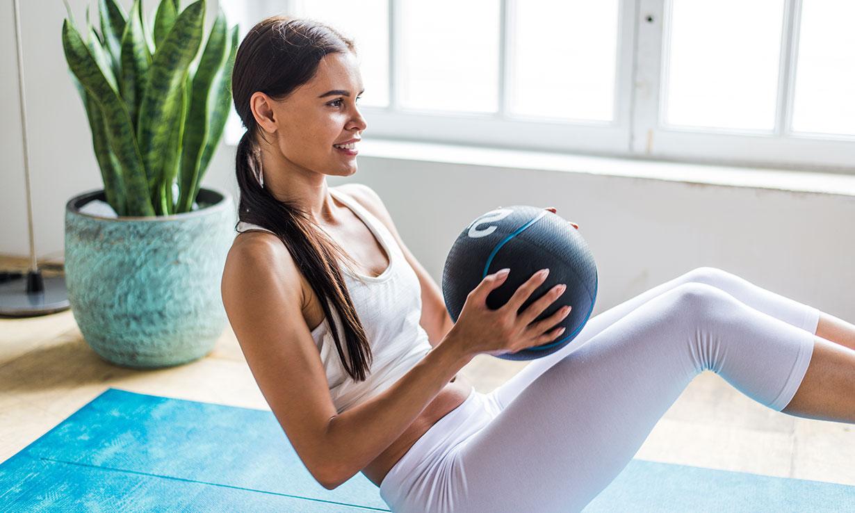 Woman using a medicine ball