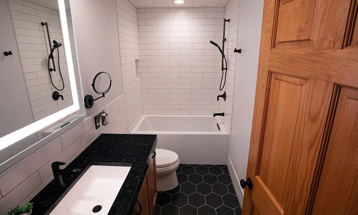 Small bathroom with bath, sink and toilet close together