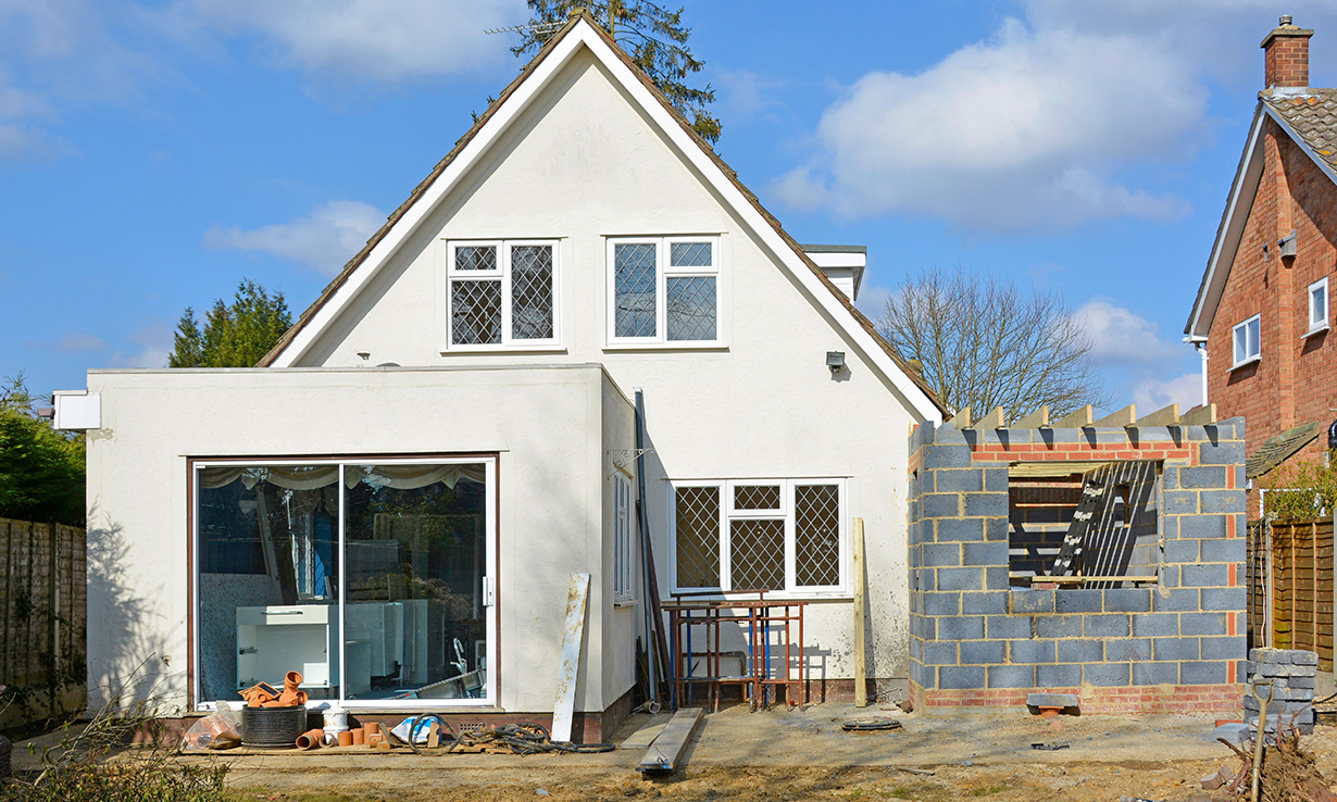 detached house with a side extension in progress