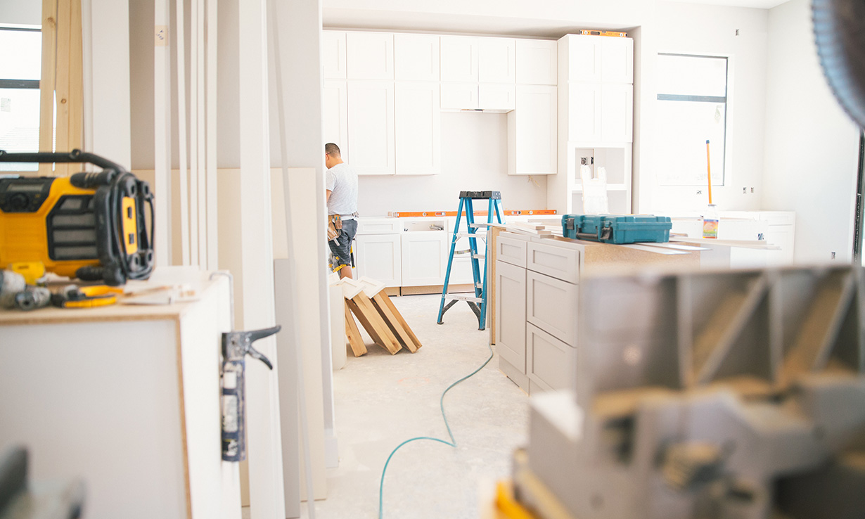 Kitchen fitters installing a white kitchen