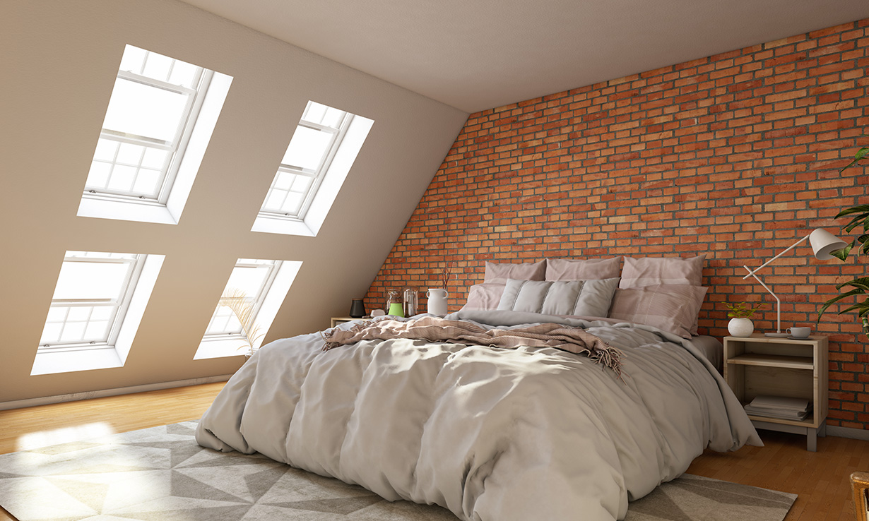 loft conversion with velux windows and a double bed