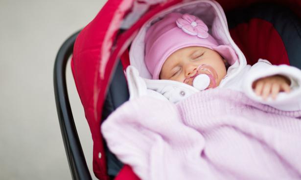 Newborn baby in a pushchair