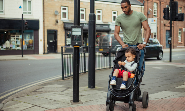 Person pushing a child in pushchair