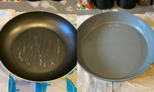 Two frying pans: one with the non stick more scratched