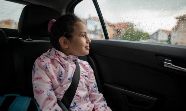 Older child sat in car using seatbelt