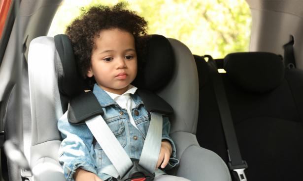 Boy sat in car seat