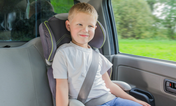 Young boy in car seat