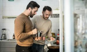 Two men cooking pancakes