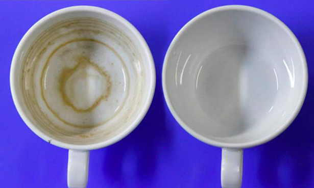 Tea-stained cup next to a clean cup