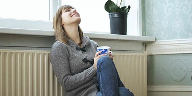 Person sitting against radiator