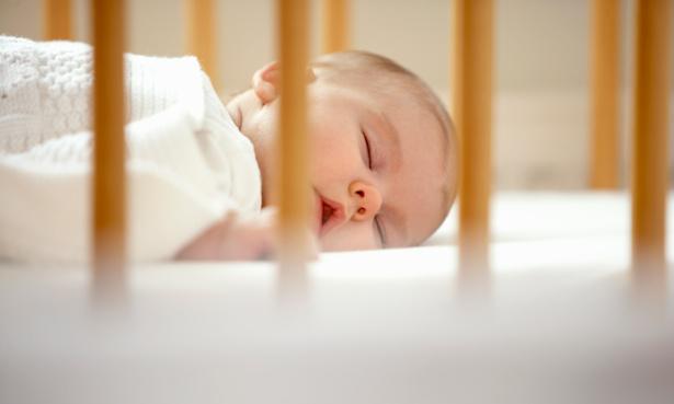 Baby sleeping in cot