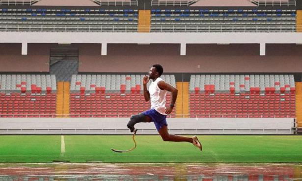 Para athlete running with a Garmin smartwatch