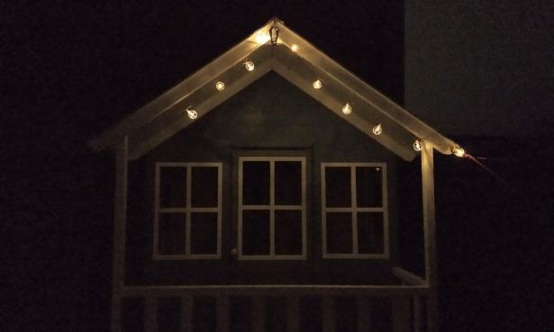 Wilko solar lights illuminating a childs playhouse.