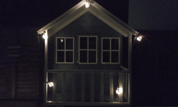 Lumify vintage bulb solar lights on a childrens playhouse.