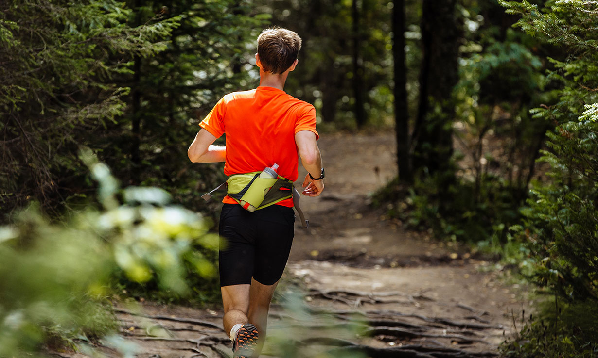 Running in the woods wearing a running belt