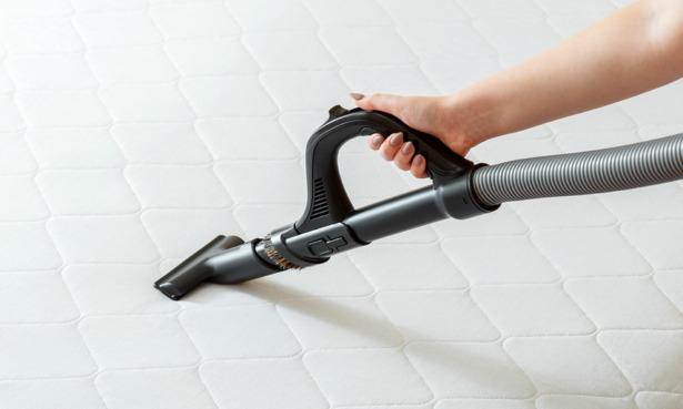 Vacuuming cot mattress