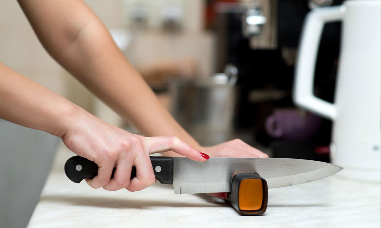 Kitchen knife and knife sharpener