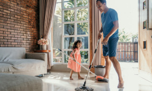 a man and girl enjoying spring cleaning