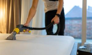 someone vacuuming a mattress
