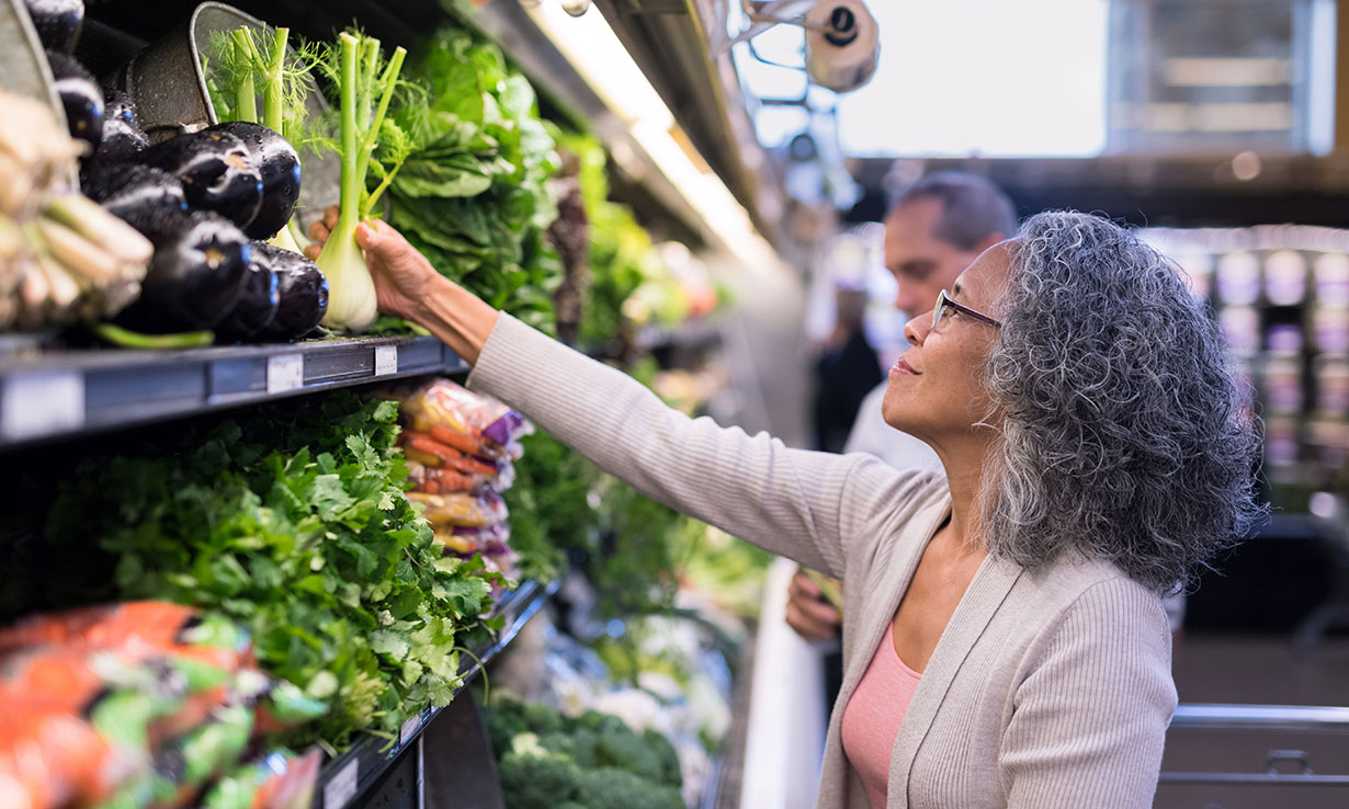 Woman shopping for fresh produce