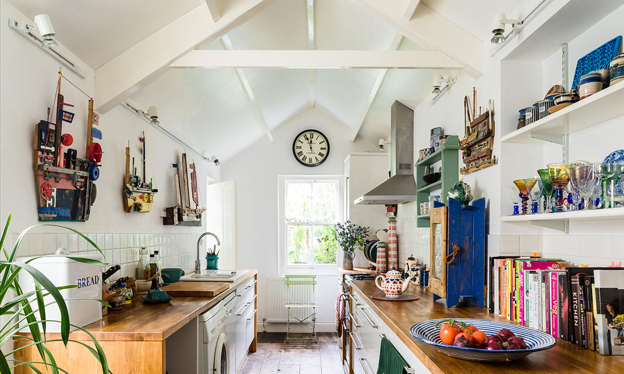 Galley kitchen with teapot on the worktop