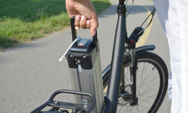 battery being removed from electric bike