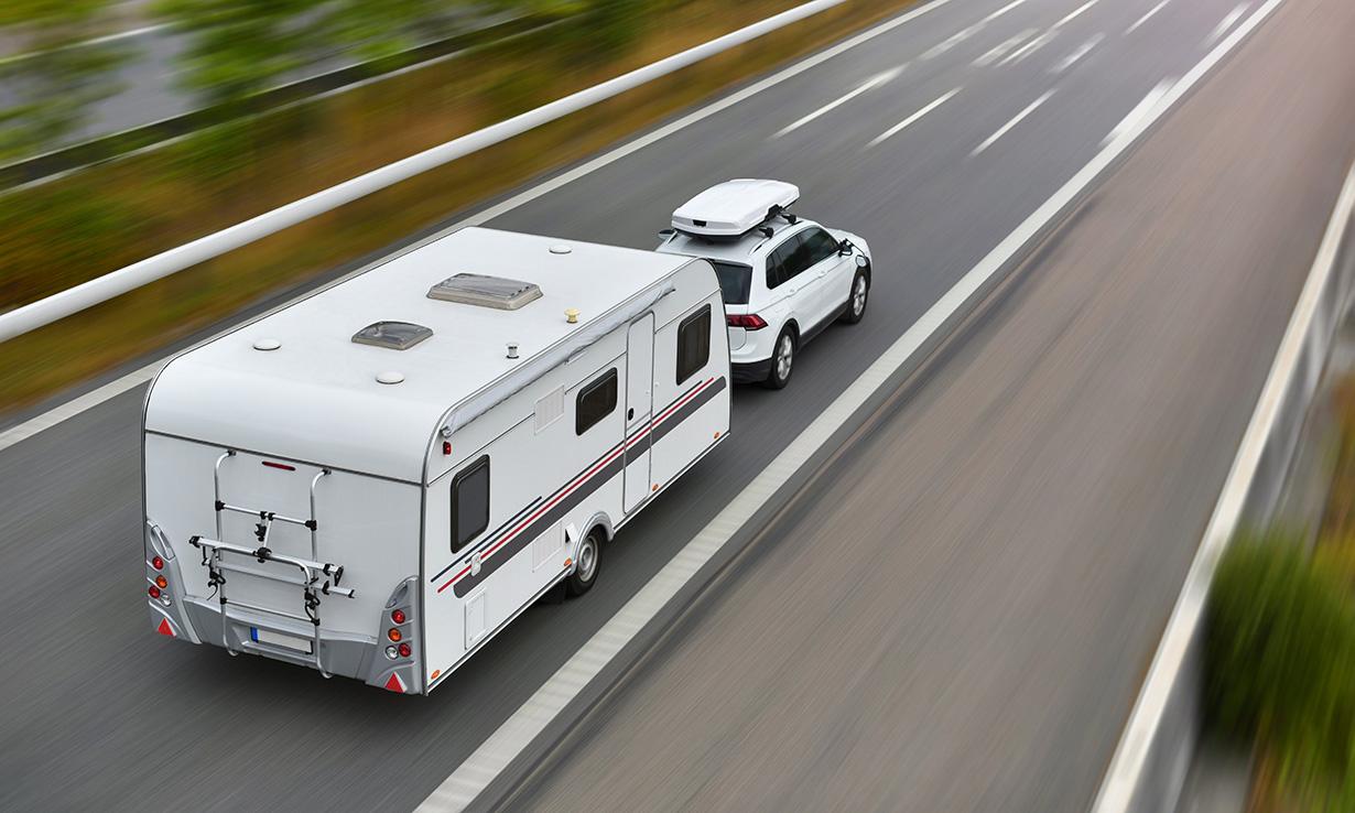 Caravan sat nav car on road