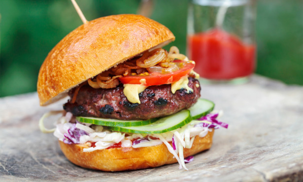 Burger in a bun with salad