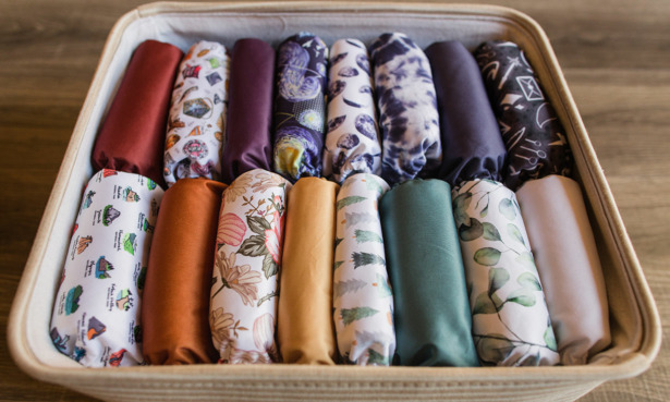 Collection of reusable nappies in basket