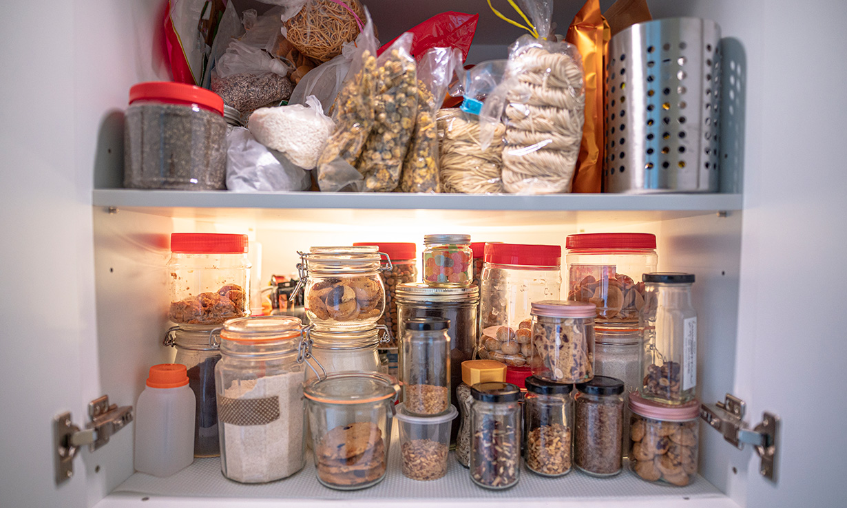 Kitchen cupboard crammed with jars