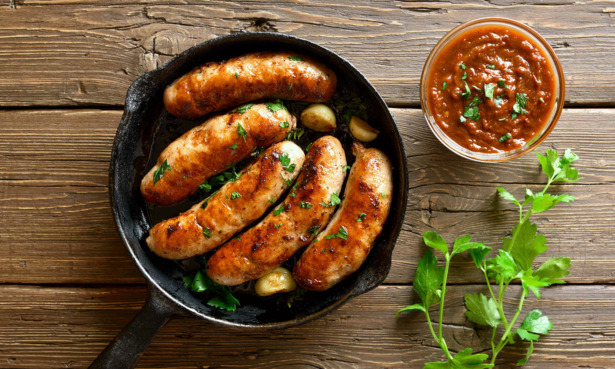 Cooked pork sausages scattered with parsley