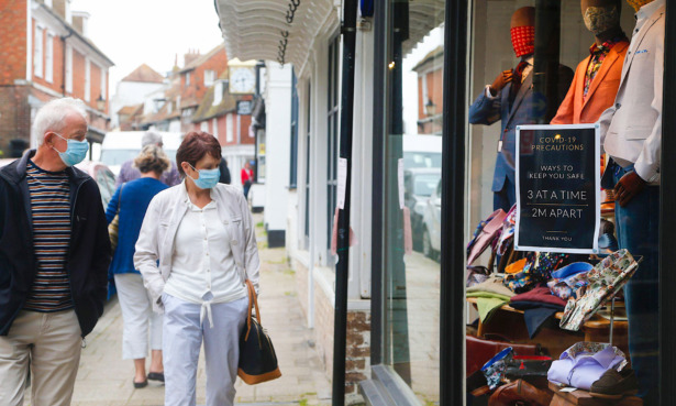 Shoppers on the high street wearing masks.