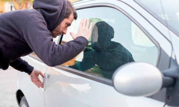 Person looking into a car window