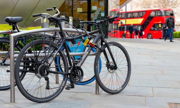 bike secured with u-locks and cable lock
